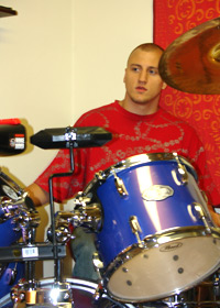 A young man at a drum set